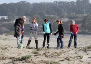 Mount Madonna School fifth and ninth graders scour the beach on the Santa Cruz County side of the Pajaro River mouth for trash Wednesday morning as they work with Save Our Shores to survey micro-plastic levels of Monterey bay beaches. (Shmuel Thaler -- Santa Cruz Sentinel)