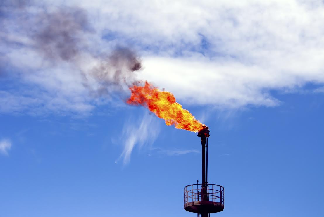 Gas flame torch on a oil refinery plant. Oil indutry. Gas refinery plant